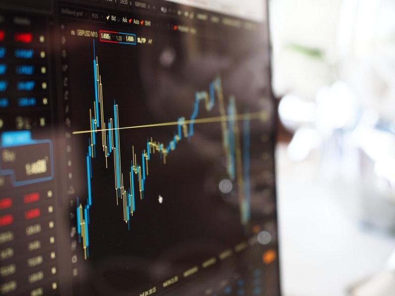 A monitor displaying a financial graph