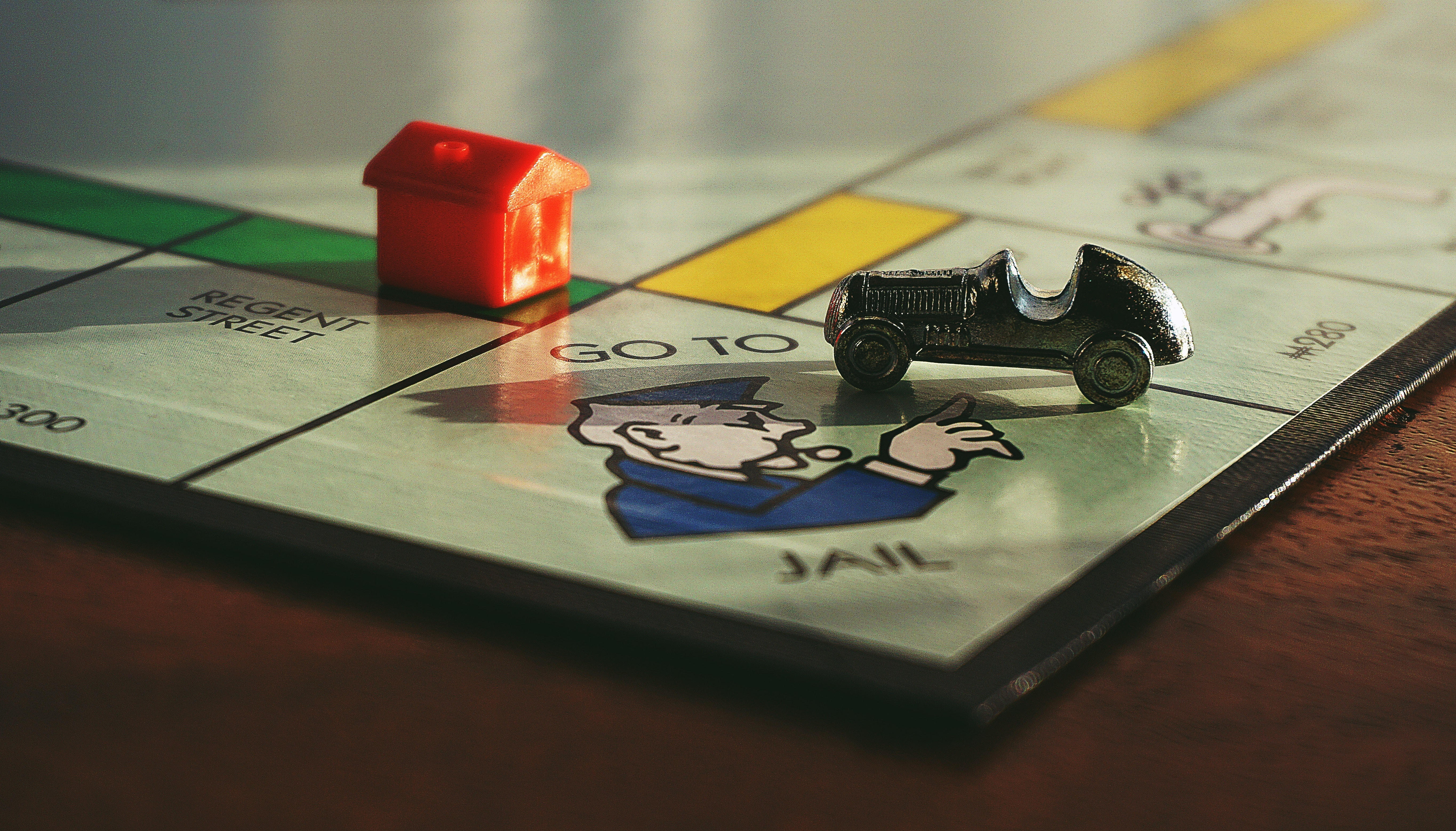 """Close up of the """"go to jail"""" corner on the monopoly board"""