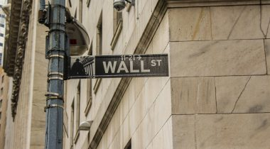 A Wall Street sign on a street pole