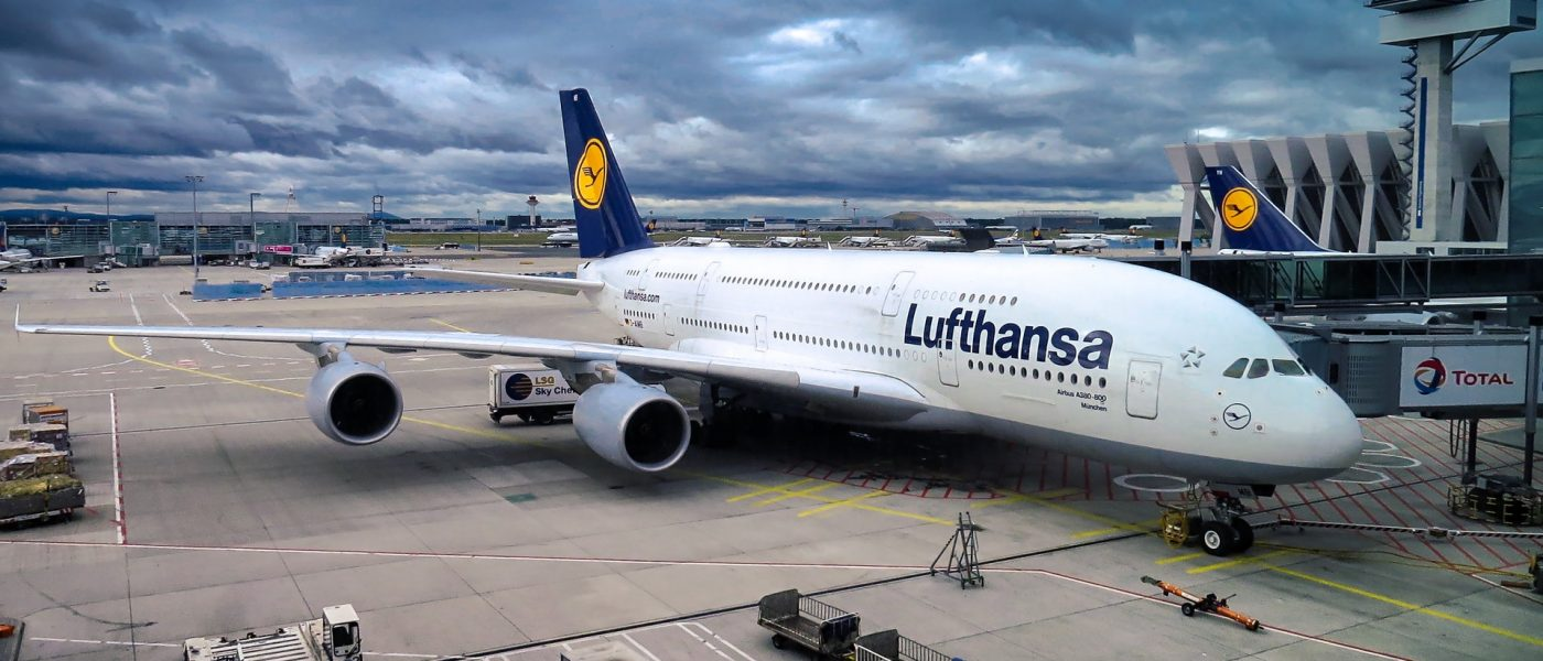 A parked Lufthansa air plane on a cloudy day