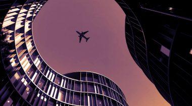 A plane flies over the Axel Towers in Copenhagen, Denmark